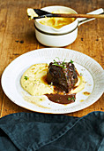 Venison cheek in a red wine sauce with mashed potatoes