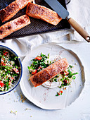 Baked salmon fillets with tahini sauce and tabbouleh