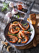 Prawns in a pan with garlic, herbs and spices