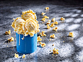 Popcorn ice cream served in a blue tin can