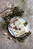 A piece of cream cake with berries on a plate