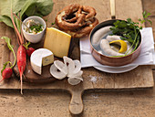 Ingredients for Bavarian snacks (white sausage, pretzel, cheese)