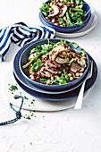 Mediterranean pork with black rice with watercress