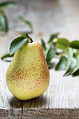 One pear on a wooden table