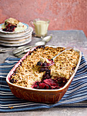 Blackberry and apple crumble with custard