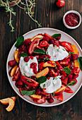 Tomato salad with peaches and burrata
