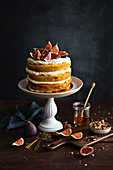 Autumn rustic naked cake with cream nuts and figs