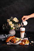 Breakfast - French croissants with butter and latte