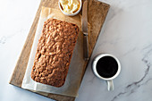 Banana bread with butter and coffee