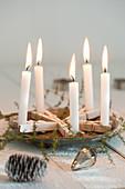 Stern aus Wäscheklammern als Kerzenhalter
