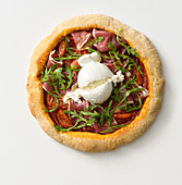 Wholemeal pizza with cured ham, burrata and rocket