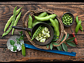 Still life with fresh beans and peas