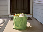 Online grocery shopping in a bag on a doorstep
