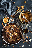 Cocoa pancakes with peanut butter and almonds