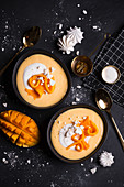 Creamy mango smoothie bowl with meringues
