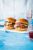 Burgers with pulled pork, pickles and coleslaw