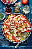 Tomatoes baked with feta, herbs and olive oil