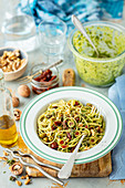 Spaghetti with dried tomatoes, walnuts and herb pesto