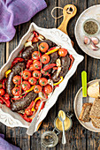 Black pudding baked with pepper and tomatoes