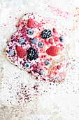 Frozen yogurt with fruit powder and berries