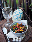 Black rice salad with mango and curry oil
