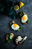 Toasts with cream cheese, green asparagus and fried egg