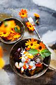 Plum dessert with yoghurt and marigolds