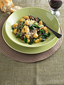 Gnocchi with mushroom and spinach sauce