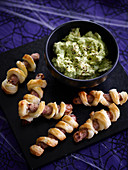 Mummy sausages with ghostly guacamole