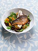 Sea bass fillets with chorizo and rocket potatoes
