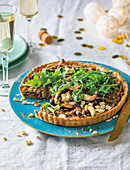 Mushroom and cashew tart with rocket