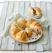 A yeast dough wreath with a salami and artichoke filling