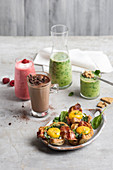 Various smoothies, chocolate milk and spinach and egg on toast