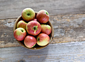 Garden apples in an olive wood bowl