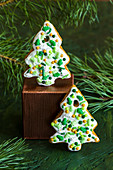 Christmas gingerbread cookies decorated with sugar sprinkles and icing