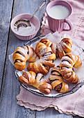 Leavened croissants with cinnamon and chocolate