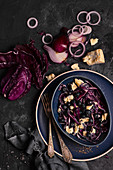 Salad with red cabbage, blueberries, blue cheese, red onion and olive oil