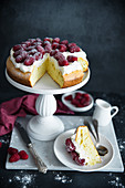 Sponge cake with whipped cream, raspberries and powdered sugar