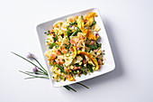 Farfalle with salmon and courgette flowers