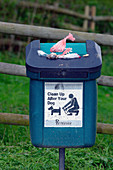 Full dog waste bin
