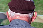 Elderly man wearing hearing aids