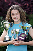 Girl with sports trophies