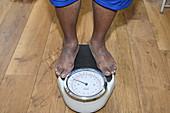 Man being weighed