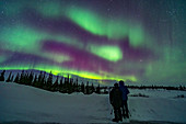Couple watching the Northern Lights