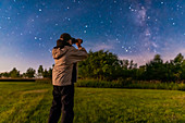 Astronomer observing the night sky