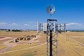 Windmill on communications tower