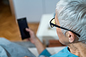 Mature woman wearing blue light blocking glasses