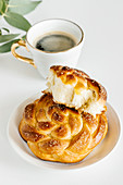 Braided sweet vanilla buns and coffee