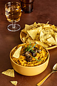 Pumpkin spice dip with mushrooms and corn tortilla chips