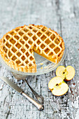 Vegan apple tart with pine nuts and a lattice lid